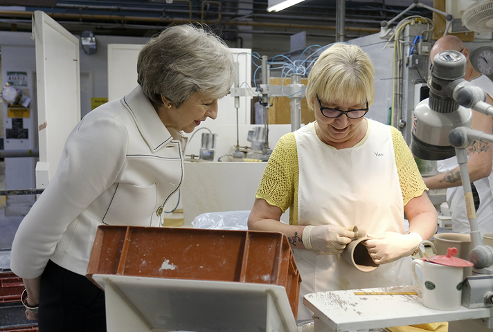 Prime Minister Theresa May speaking to worker in pottery factory