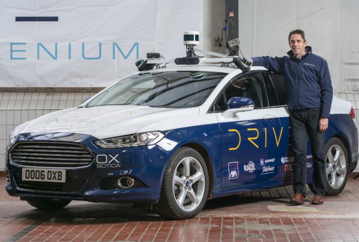 Oxbotica's CEO Graeme Smith with their autonomous vehicles in Oxford