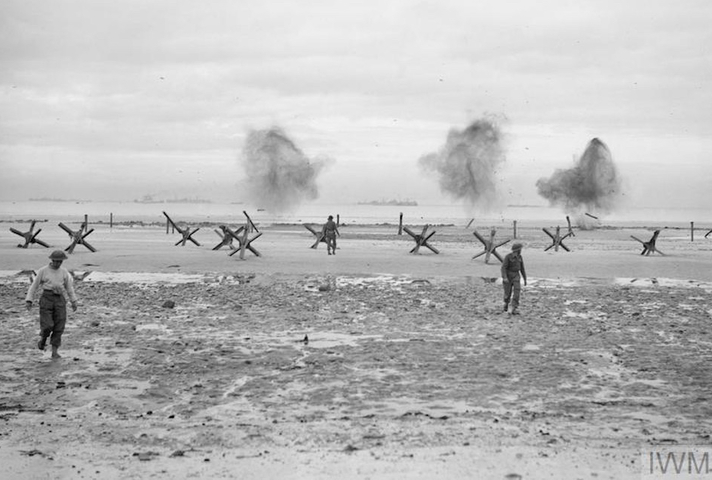 Troops land on a beach at Normandy, 75 years ago. © IWM (A 23993)