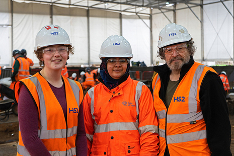 Three trainee archaeologists in high vis, working on HS2 projects