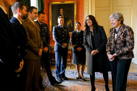 PM Theresa May and PM Ardern meet military personnel