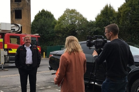 Fire Wales challenge owner being interviewed in front of fire engine