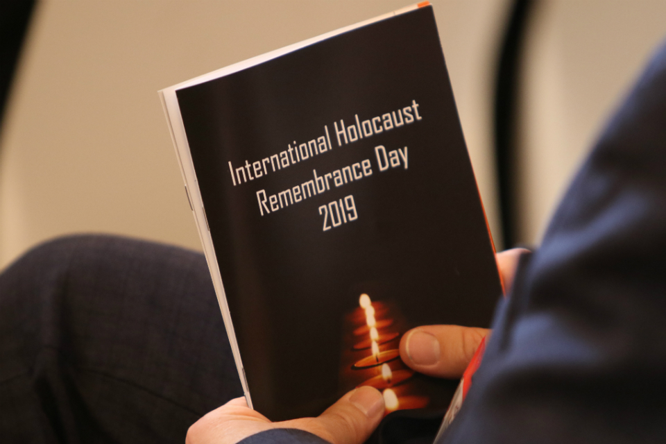 International Holocaust Remembrance Day 2019 event, person holding a book