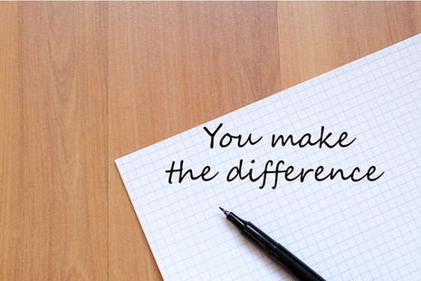 Paper and pen with the words 'you make the difference' written on it.