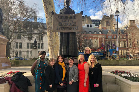 Members of the WiN Cumbria team with Trudy Harrison MP at the Millicent Fawcett statue in London