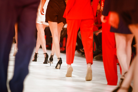 Legs of male and female models on catwalk