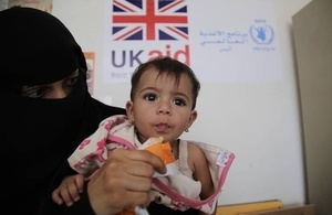 A woman feeds a malnourished child with therapeutic food funded by UK aid in Yemen. Picture: WFP