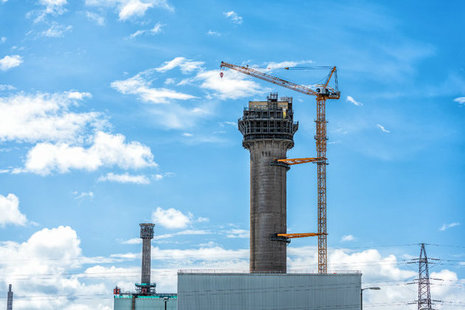 The first blocks of concrete has been removed from the top of one of the world's most recognisable chimneys.