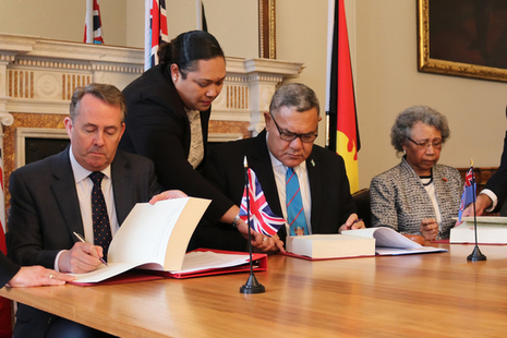 International Trade Secretary signs a trade continuity agreement with the High Commissioners of Fiji and Papua New Guinea