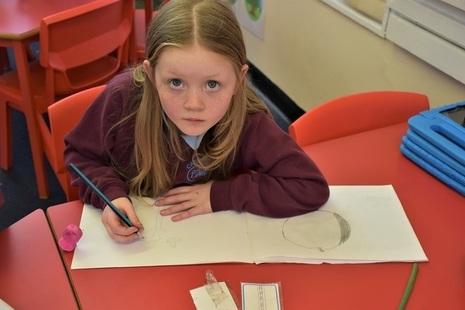 Female pupil writing at desk