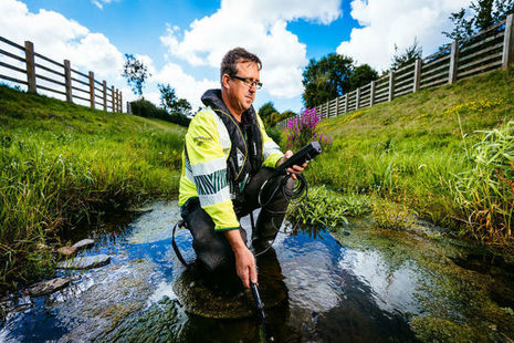 Environment Agency officer doing a water sample test
