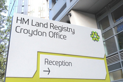 Sign directing people to the the Croydon Office reception.