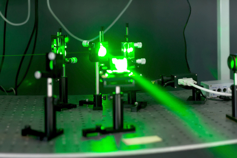 A image of a green laser beam and emitter.