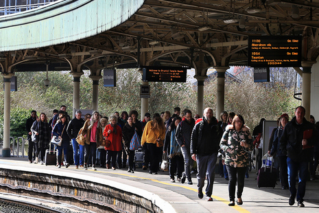 Picture of passengers at Bristol train station.