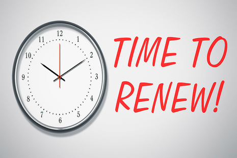 Clock on wall and text saying time to renew