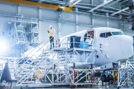 An engineer inspecting an aircraft