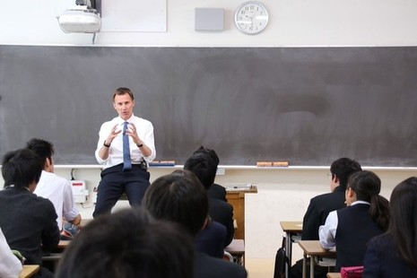 Foreign Sec teaching Japanese school children english