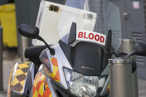 A parked motorbike for transporting donated blood.