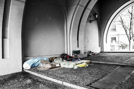 Sleeping bags under a bridge.