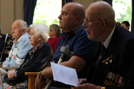 Residents look on during the memorial service.