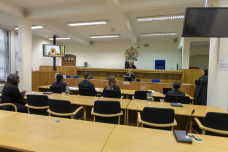 People sitting in a courtroom