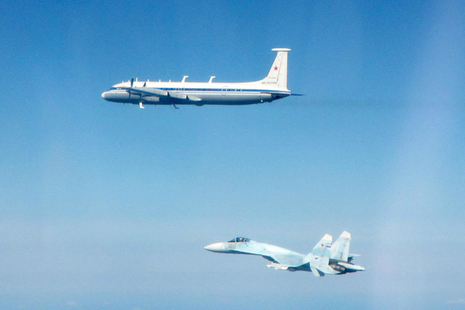 Two Russian aircraft fly in the sky after being intercepted by RAF Typhoons