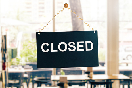 Closed sign on a glass office door.