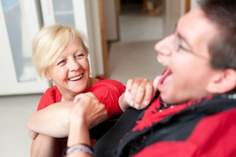 A carer talking to a man with a learning disability.