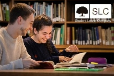 Image of: students at desk with slc logo