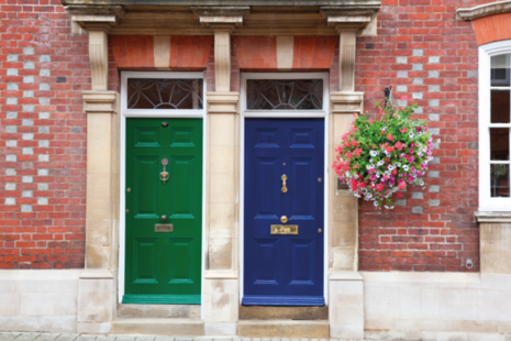Front doors of terraced houses on a residential estate.