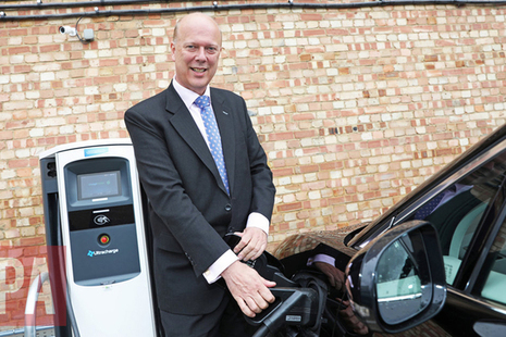 Chris Grayling with electric vehicle