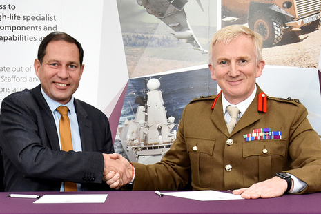 DECA Chief Executive Geraint Spearing shaking hands with Colonel Nick Lock, Deputy Commander 160 Brigade