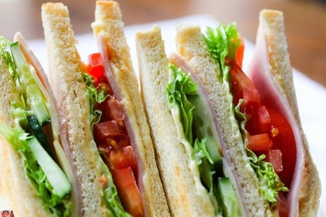 Ham, cheese and salad sandwiches cut into triangles