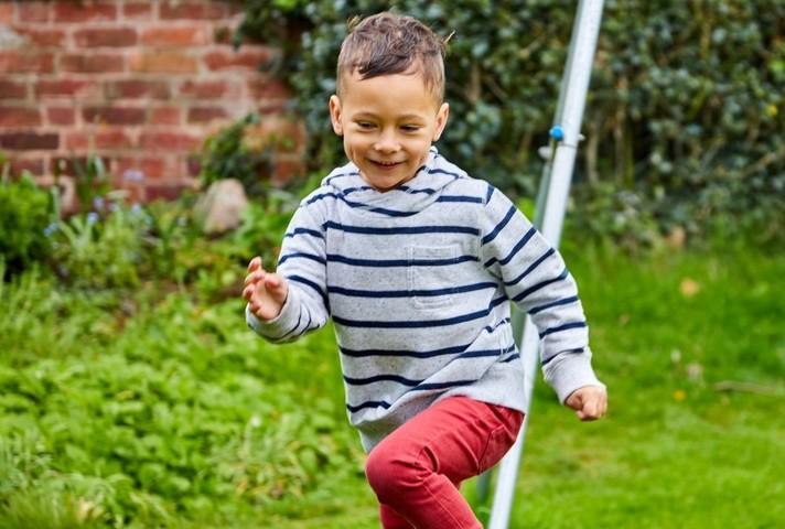 Little boy running around outdoors
