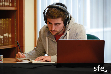 Image of person studying at desk