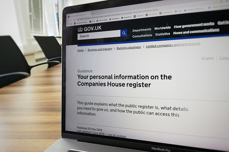 A laptop screen displaying a webpage titled 'Your personal information on the Companies House register'.