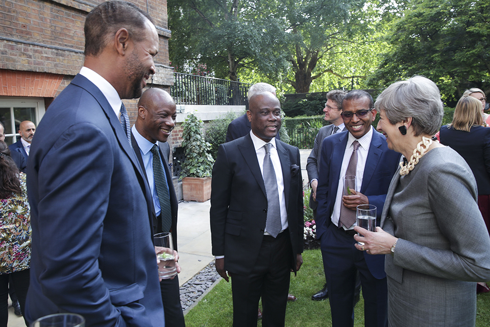 Prime Minister Theresa May speaking to business leaders at a reception in the Downing Street garden