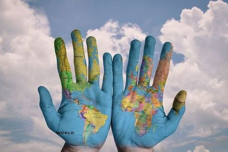 hands with european map printed on them