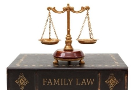 Picture of scales on top of family law book
