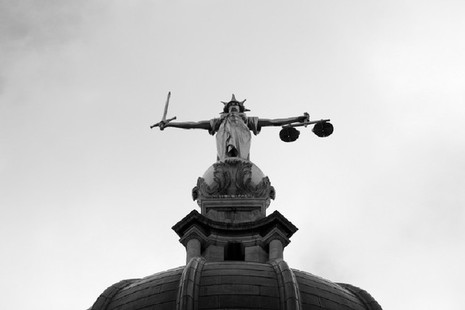 Picture showing the 'Lady Justice' statue on top ot the Old Bailey in London