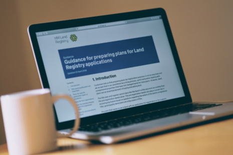 A laptop computer displaying guidance for preparing plans for Land Registry applications