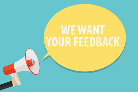 Megaphone with the words 'we want your feedback'