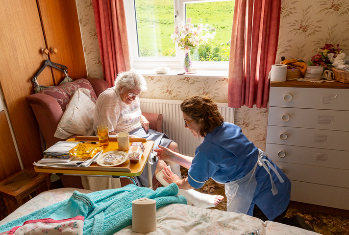 Nurse helping lady at home