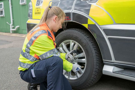 Traffic Officer Hannah Moffitt checks tyres on a Highways England vehicle