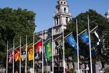 County flags flying at Parliament Square, London