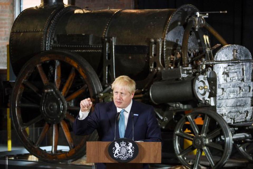 Photo of Boris Johnson in front of Stephenson's rocket.