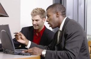Customers looking at a computer.
