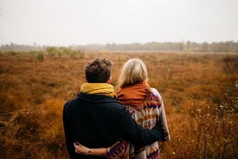 Man and woman standing in a field
