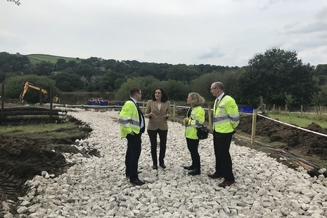 Theresa Villiers and Emma Howard-Boyd talking with officials at Whaley Bridge