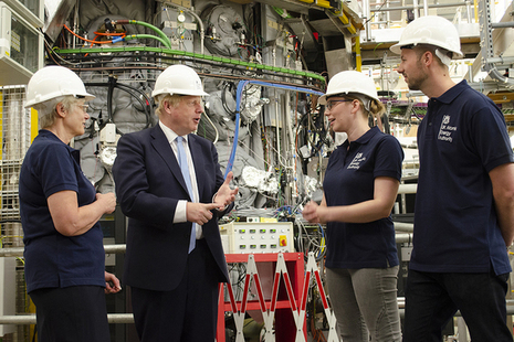 Prime Minister Boris Johnson at the MAST Upgrade fusion experiment with UKAEA staff (left to right): Nanna Heiberg, Stephanie Hall and Matthew Carr.